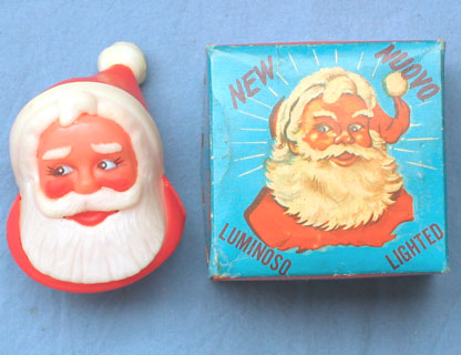 "On one side of the box is printed ""THE NEW BRIGHT Santa Claus FOR YOUR CAR   dry battery operated   PATENTED  see instructions inside the box   MADE IN ITALY  NO. 1317"" plus in Italian, German and French on each of the other sides. The box is the container for two batteries, plus the electrical wire with a small switch and a lamp for insertion in the Santa head."