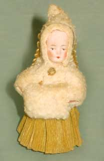Angel with bisque head, unmarked, with Dresden wings , crépe skirt and cotton cape and muff.